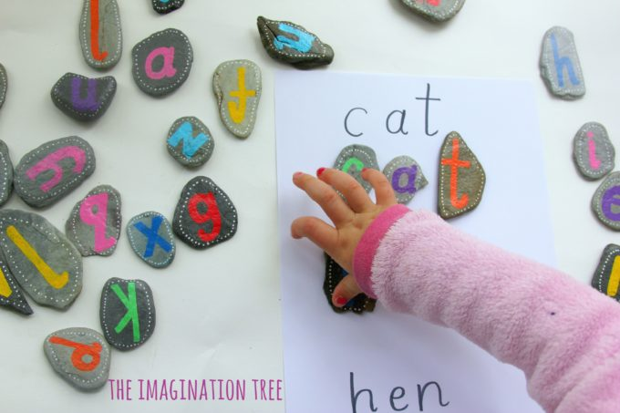 Matching letters and spelling words with alphabet pebbles!