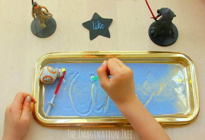 Writing letters and sight words in a star wars sensory writing tray