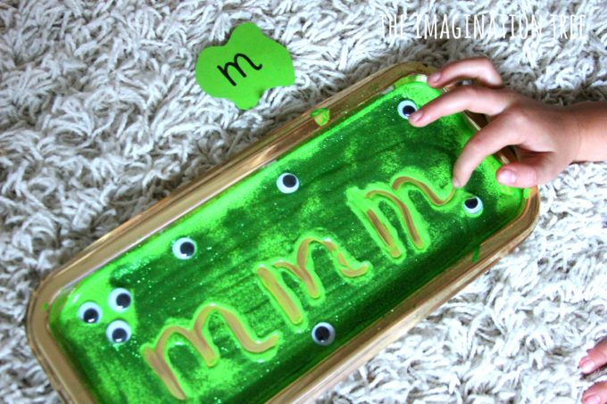writing-in-a-monster-slime-sensory-writing-tray