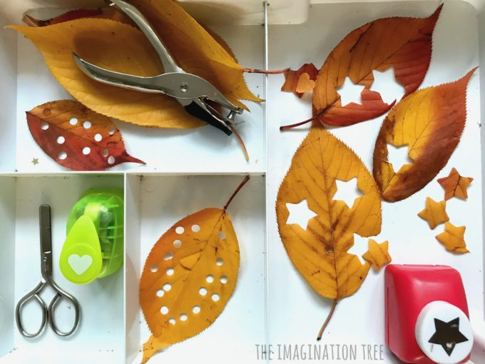 Hole punching leaves confetti activity tray for kids!
